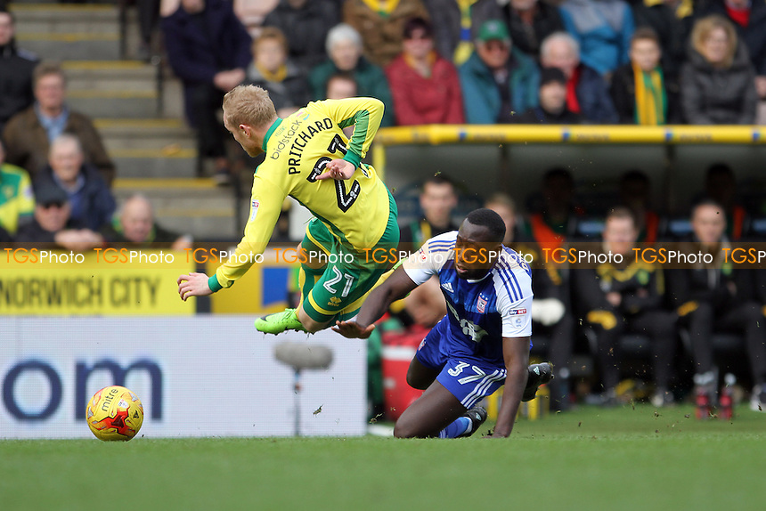 Alex Pritchard of Norwich City goes down under a challenge from Toumani Diagouraga of Ipswich Town during Norwich City vs Ipswich Town, Sky Bet EFL Championship Football at Carrow Road on 26th February 2017