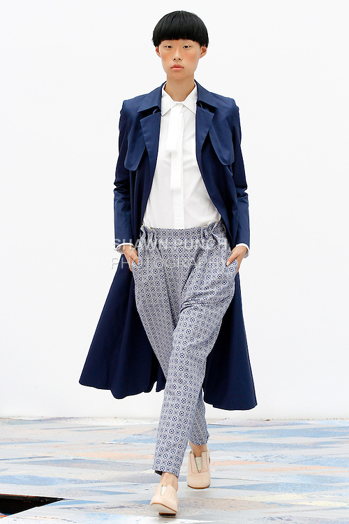 Model walks runway in an outfit from the Tia Cibani Spring Summer 2014 collection, during New York Fashion Week Spring 2014, September 4, 2013.