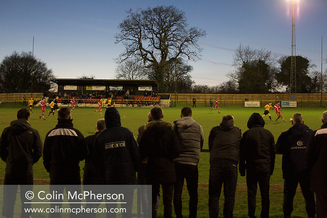 Spectators watching the action during the second-half at Lye Meadow as Alvechurch (in amber) hosted Highgate United in a Midland Football League premier division match. Originally founded in 1929 and reformed in 1996 after going bust, the club has plans to move from their current historic ground to a new purpose-built stadium in time for the 2017-18 season. Alvechurch won this particular match by 3-0, watched by 178 spectators, taking them back to the top of the league.