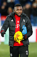 Isaac Success of Watford walks to the bench with a hot water bottle under his arm during the Premier League match between Crystal Palace and Watford at Selhurst Park, London, England on 13 December 2017. Photo by Carlton Myrie / PRiME Media Images.
