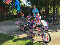 NWA Democrat-Gazette/SPENCER TIREY Camryn Hodge (8) prepares to rides her bike Wednesday, July 4, 2018, with other from her neighborhood in a 4th of July parade on Turtle Creek Drive in Rogers. Camryn who organized the event said she organized it because she wanted to show how much she loved America and wanted to make new friends.