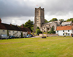 Church of St Michael and butter cross on the village green in Aldbourne, Wiltshire, England, UK