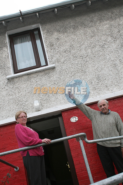 Oliver and Maeve McEnany show the water damage to their house..Photo NEWSFILE/Jenny Matthews.(Photo credit should read Jenny Matthews/NEWSFILE)....This Picture has been sent you under the condtions enclosed by:.Newsfile Ltd..The Studio,.Millmount Abbey,.Drogheda,.Co Meath..Ireland..Tel: +353(0)41-9871240.Fax: +353(0)41-9871260.GSM: +353(0)86-2500958.email: pictures@newsfile.ie.www.newsfile.ie.FTP: 193.120.102.198.