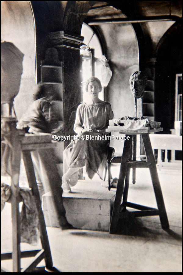 BNPS.co.uk (01202 558833)<br /> Pic: BlenheimPalace/BNPS<br /> <br /> Sculpter Jacob Epstein at work on a portrait of Gladys in the undercroft at Blenheim.<br /> <br /> The 'Most beautiful woman in the world' finally return's to Blenheim Palace.<br /> <br /> The treasured painting kept by a Duchess of Blenheim once described as 'the most beautiful woman in the world' through her declining years has finally returned to the Oxfordshire Palace 103 years after it was painted.<br /> <br /> American Gladys Deacon married the 9th Duke of Marlborough in 1921, five years after her portrait was painted in Paris by Italian artist Giovanni Boldini.<br /> <br /> But the marriage became troubled and the Duke finally evicted Gladys from the Palace in the ealy 1930's, she then became an eccentric recluse, before finally ending her days in a psychiatric hospital.<br /> <br /> When evicted Gladys took a few treasured possessions with her, including a statue given her by Rodin, and this glamorous portrait from her stunning younger days.