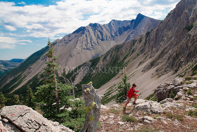 A hiker on the boulders at the head of Strawberry Creek in the Bob Marshall Wilderness in Montana