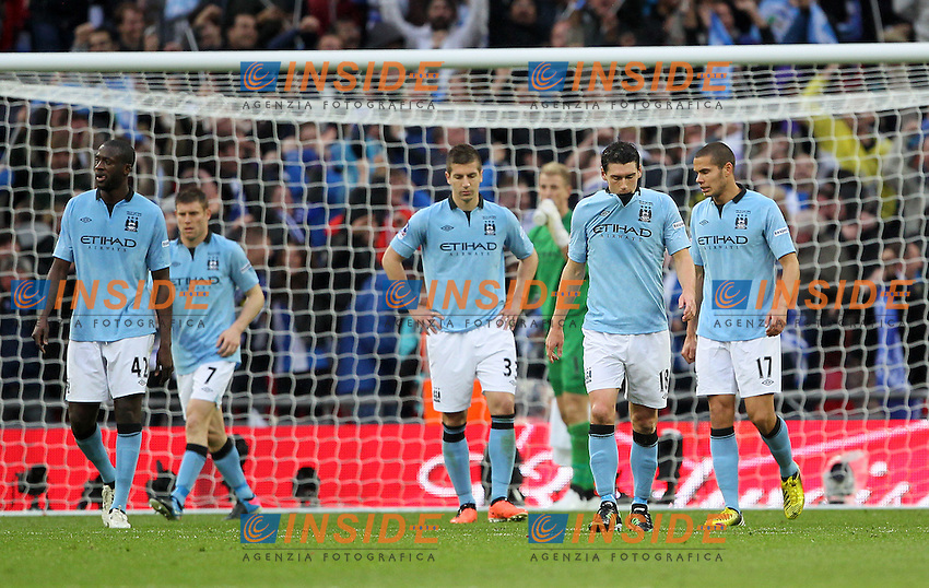 Manchester City's players look on dejected after going 1-0 down..- FA Cup Final - Manchester City vs Wigan Athletic - Wembley Stadium - London - 11/05/2013 - Pic David Klein/Sportimage .Football Calcio 2012/2013.Finale FA CUP .Foto Insidefoto .ITALY ONLY