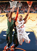 Virginia forward Akil Mitchell (25) shoots next to Miami guard Rion Brown (15)  during an NCAA basketball game Saturday Feb, 24, 2014 in Charlottesville, VA. Virginia defeated Miami 65-40.