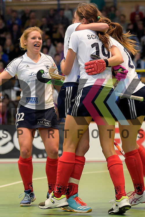 GER - Luebeck, Germany, February 07: During the 1. Bundesliga Damen indoor hockey final match at the Final 4 between Mannheimer HC (blue) and Duesseldorfer HC (white) on February 7, 2016 at Hansehalle Luebeck in Luebeck, Germany. Final score 6-4 after shootout.  Selin Oruz #14 of Duesseldorfer HC is congratulated by teammates; (L-R) Greta Gerke #22 of Duesseldorfer HC, Lisa-Marie Schuetze #19 of Duesseldorfer HC, Selin Oruz #14 of Duesseldorfer HC, Elisa Graeve #26 of Duesseldorfer HC