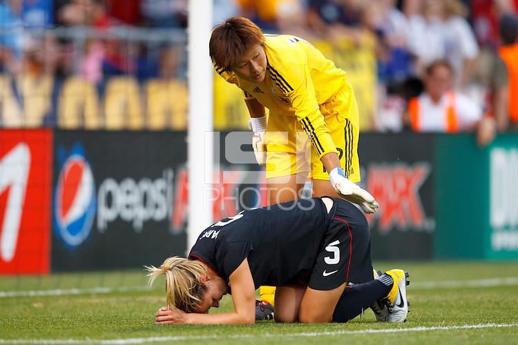 14 MAY 2011: Japan National team Ayumi Kaaihori checks on USA Women's National Team midfielder Lindsay Tarpley (5) after she twisted her knee during the International Friendly soccer match between Japan WNT vs USA WNT at Crew Stadium in Columbus, Ohio.