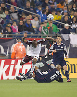 New England Revolution midfielder Ousmane Dabo (6) slide tackles Colorado Rapids defender Marvell Wynne (22). In a Major League Soccer (MLS) match, the New England Revolution tied the Colorado Rapids, 0-0, at Gillette Stadium on May 7, 2011.