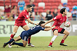 Madison Hughes of USA tries to tackle Nathan Hirayama of Canada, who runs with the ball during the match United States vs Canada, the Cup Final of the HSBC Singapore Rugby Sevens as part of the World Rugby HSBC World Rugby Sevens Series 2016-17 at the National Stadium on 16 April 2017 in Singapore. Photo by Victor Fraile / Power Sport Images