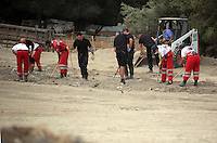 Pictured: Forensics officers and Red Cross volunteers go through soil at the farmhouse site, where Ben Needham disappeared from in Kos, Greece. Wednesday 12 October 2016<br />