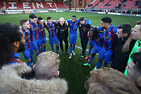 Maldon players huddle after victory during Leyton Orient vs Maldon & Tiptree, Emirates FA Cup Football at The Breyer Group Stadium on 10th November 2019