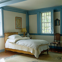 In this pretty blue-and-white bedroom a Chinese carpet and ginger jar blend seamlessly with the 18th-century bed and furniture