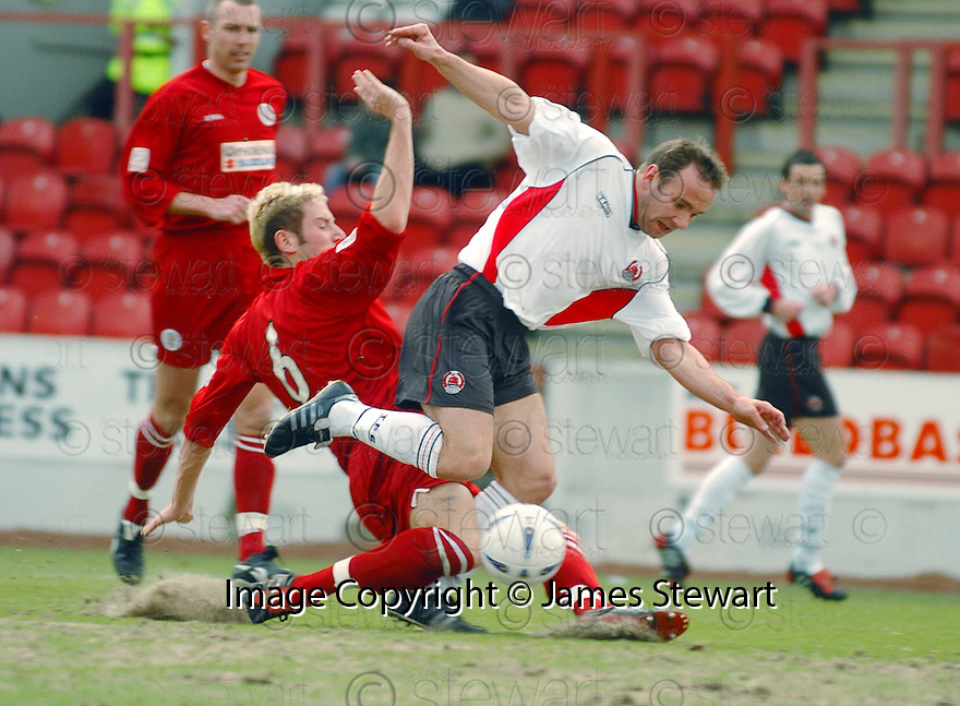 20040327     Copyright Pic : James Stewart.File Name : jspa01_clyde_v_stmirren.IAN HARTY IS BROUGHT DOWN BY KIRK BROADFOOT FOR CLYDE'S PENALTY.....James Stewart Photo Agency 19 Carronlea Drive, Falkirk. FK2 8DN      Vat Reg No. 607 6932 25.Office     : +44 (0)1324 570906     .Mobile  : +44 (0)7721 416997.Fax         :  +44 (0)1324 570906.E-mail  :  jim@jspa.co.uk.If you require further information then contact Jim Stewart on any of the numbers above.........