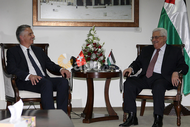Palestinian president Mahmoud Abbas (R) meets with Swiss Foreign Minister Didier Burkhalter upon the latter's arrival in the West Bank city of Ramallah on May 2, 2013. Photo by Thaer Ganaim