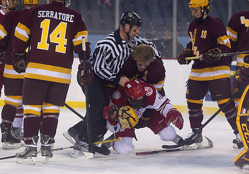 February 17, 2013:  The linesman breaks up scuffle between Minnesota defenseman Seth Helgeson (4) and Wisconsin forward Sean Little (18) during NCAA Hockey game action between the Minnesota Golden Gophers and the Wisconsin Badgers at Soldier Field in Chicago, Illinois.  Wisconsin defeated Minnesota 3-2.