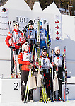 The top 6 competitors pose for photos after The International Biathlon Union Cup # 7 Men's 10 KM Sprint held at the Canmore Nordic Center in Canmore Alberta, Canada, on Feb 16, 2012.  In first place center rear is Canadian Nathan Smith, 2nd is Austrian Friedrich Pinter left rear, and Russian Sergey Klyachin right rear in 3rd place. 4th, 5th and 6th place left to right and in the front are Norway's Martin Eng, Canada's Marc-Andre Bedard and Norway's Vegar Bergli.  Photo by Gus Curtis.