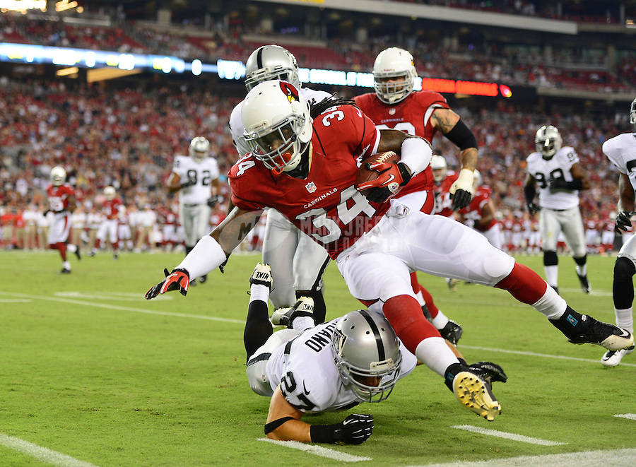 Aug. 17, 2012; Glendale, AZ, USA; Arizona Cardinals running back (34) Ryan Williams is tackled by Oakland Raiders safety (27) Matt Giordano in the first quarter during a preseason game at University of Phoenix Stadium. Mandatory Credit: Mark J. Rebilas-