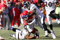 Ravens linebacker Adalius Thomas (96) and cornerback Chris McAlister (21) tackle Chiefs wide receiver Dante Hall on a 14 yard pass play during the first quarter at Arrowhead Stadium in Kansas City, Missouri on December 10, 2006. Baltimore won 20-10.
