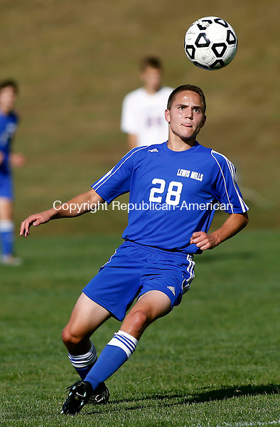 Woodbury, CT- 21 September 2015-092115CM06- NEWS ACTION MAN--- Lewis Mills' Austin Gilbert keeps his eye on the ball during their Berkshire League soccer matchup against Nonnewaug in Woodbury on Monday.    Christopher Massa Republican-American