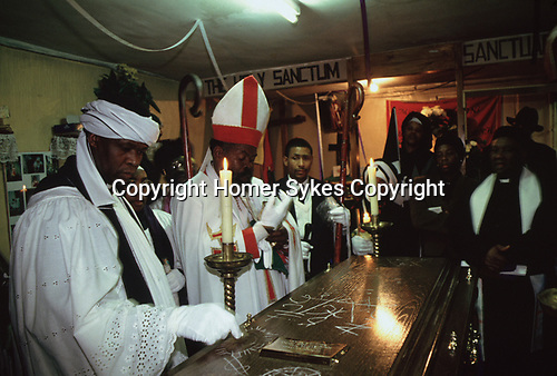 Mount Zion Baptist Church north London. Bishop Noel has died, at his funeral service in the small church building his brothers both Bishops of their own churches in the Caribbean attend. from A STORM IS PASSING OVER a Look at Black Churches in Britain. Published by Thames and Hudson isbn 0 500 27826 1
