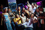 The first GNH Fund participants let their hair down at a club in Thimphu, Bhutan. Photo: Sanjit Das/Panos