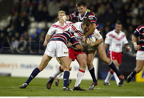 DARREN BRITT tackled by Craig Fitzgibbon & Peter Cusack. ST HELENS 0 v Sydney Roosters 38, World Club Challenge 2003, Reebok Stadium, Bolton 030214 Photo:Neil Tingle/Action Plus...rugby league.player superleague