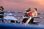 Luis Grajeda from Chihuahua, Mexico, right, fights Willie Nelson from Cleveland, Ohio at sunset during the Light Middleweight main event of the Rural Rumble on Friday night, August 8, 2014 at Churchill County Fairgrounds in Fallon, Nevada.