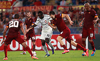 Calcio, Champions League, Gruppo E: Roma vs CSKA Mosca. Roma, stadio Olimpico, 17 settembre 2014.<br /> CSKA Moskva forward Seydou Doumbia, of Ivory Coast, second from left, is challenged, from left, by Roma's Seydou Keita, Kostas Manolas and Maicon during the Group E Champions League football match between AS Roma and CSKA Moskva at Rome's Olympic stadium, 17 September 2014.<br /> UPDATE IMAGES PRESS/Isabella Bonotto