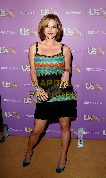 SARA RUE.Attends The US Weekly Young Hollywood Hot 20 Party held at LAX in Hollywood,.Los Angeles, 16th September 2005.full length black green orange pattern knitted wool dress clutch bag.Ref: DVS.www.capitalpictures.com.sales@capitalpictures.com.Supplied By Capital PIctures