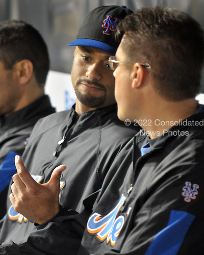 Baltimore, MD - June 16, 2009 -- New York Mets pitcher Johan Santana (57) speaks with trainer Mike Herbst as he watches the game against the Baltimore Orioles from the dugout at Orioles Park at Camden Yards in Baltimore, Maryland on Tuesday, June 16, 2009.  The Mets won the game 6 - 4..Credit: Ron Sachs / CNP.(RESTRICTION: NO New York or New Jersey Newspapers or newspapers within a 75 mile radius of New York City)