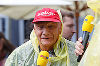 MELBOURNE, 17 MARCH - Three-time F1 World Champion Niki Lauda hams up the heavy rain that caused the postponement of qualifying prior to the 2013 Formula One Rolex Australian Grand Prix at the Albert Park Circuit in Melbourne, Australia. Photo Sydney Low/syd-low.com