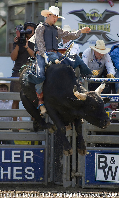 Tyler Smith, from Fruita, CO. tries to hang onto Justice Juice during the Xtreme Bull Riding Competition at the Kitsap County Fair and Stampede  held Aug. 26 to Aug. 30, 2009 in Silverdale, WA. Jim Bryant Photo.  Jim Bryant Photo. All Right Reserved. © 2009