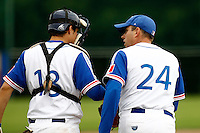 21 June 2011: Jerome Debrais of Team France talks to Boris Marche as he pitches against UCLA Alumni during UCLA Alumni 5-3 win over France, at the 2011 Prague Baseball Week, in Prague, Czech Republic.