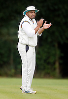 Harrow captain A Javed motivates his team during the Middlesex County League Division two game between Highgate and Harrow at Park Road, Crouch End on Sat Jun 25, 2011