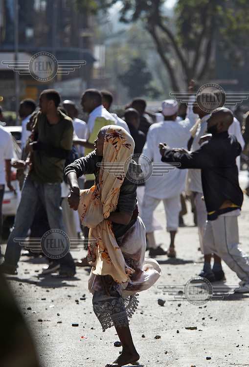 Muslims clash with the authorities and Christian Kenyans after Friday prayers outside the Jamia Mosque in central Nairobi. They were protesting the detention of cleric Abdullah al-Faisal by the Kenyan authorities.
