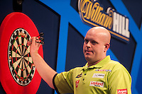 01.01.2014.  London, England.  William Hill PDC World Darts Championship.  Quarter Final Round.  Michael van Gerwen (1) [NED] removes his darts after a 170 finish to win the match against Robert Thornton (9) [SCO]. Michael van Gerwen won the match 5-2