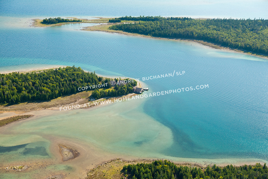 home and boathouse on tip of Boot Island shoreline, Les Cheneaux area of Lake Huron near Cedarville, MI