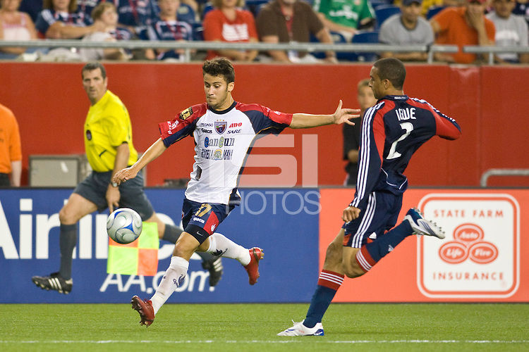 Atlante FC midfielder Jose Daniel Guerrero (17) and New England Revolution defender Amaechi Igwe (2). The New England Revolution defeated Atlante FC 1-0 during a SuperLiga semifinal match at Gillette Stadium in Foxborough, MA, on July 30, 2008.