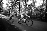 Andr&eacute; Greipel (DEU) has a flat after a very dangerous descent full of putholes. Teammate Frederik Willems (BEL) stops to give up his wheel and with the teamcar still far behind, it's DIY-time for the riders.<br /> <br /> 2013 Ster ZLM Tour <br /> stage 4: Verviers - La Gileppe (186km)