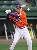Head coach Jack Leggett (7) of the Clemson Tigers hits infield practice prior to a game against the South Carolina Gamecocks on Saturday, March 2, 2013, at Fluor Field at the West End in Greenville, South Carolina. Clemson won the Reedy River Rivalry game 6-3. (Tom Priddy/Four Seam Images)