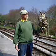 Transition Town Series. March 2011. Totnes, Devon. Peter & Merlin. Peter works at Totnes Rare Breeds Farm located just outside of Totnes Town. Merlin is a Siberian Eagle Owl.