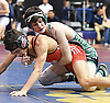 Kevin DiPalma of Farmingdale, top, battles Lee Mauras of Freeport at 120 pounds during the Nassau County Divsision I varsity wrestling quarterfinals at Hofstra University on Saturday, Feb. 11, 2017. DiPalma won the match by technical fall at 4:17.