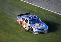Jul. 5, 2008; Daytona Beach, FL, USA; NASCAR Sprint Cup Series driver A.J. Allmendinger drives through the grass after blowing a tire during the Coke Zero 400 at Daytona International Speedway. Mandatory Credit: Mark J. Rebilas-