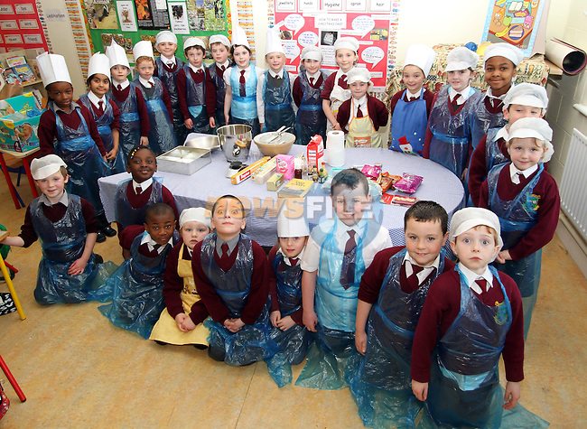 Tullyallen NS 1st Class students making a Christmas Cake with their teacher Ms Clarke...(Photo credit should read Jenny Matthews www.newsfile.ie)....This Picture has been sent you under the condtions enclosed by:.Newsfile Ltd..The Studio,.Millmount Abbey,.Drogheda,.Co Meath..Ireland..Tel: +353(0)41-9871240.Fax: +353(0)41-9871260.GSM: +353(0)86-2500958.email: pictures@newsfile.ie.www.newsfile.ie.