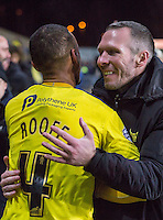 Michael Appleton Manager of Oxford United embraces Kemar Roofe of Oxford United during the Johnstone's Paint Trophy Southern Final 2nd Leg match between Oxford United and Millwall at the Kassam Stadium, Oxford, England on 2 February 2016. Photo by Andy Rowland / PRiME Media Images.
