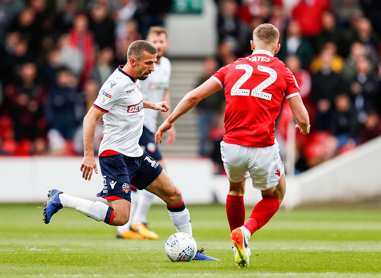 Bolton Wanderers' Gary O'Neil competing with Nottingham Forest's Ryan Yates <br /> <br /> Photographer Andrew Kearns/CameraSport<br /> <br /> The EFL Sky Bet Championship - Nottingham Forest v Bolton Wanderers - Sunday 5th May 2019 - The City Ground - Nottingham<br /> <br /> World Copyright © 2019 CameraSport. All rights reserved. 43 Linden Ave. Countesthorpe. Leicester. England. LE8 5PG - Tel: +44 (0) 116 277 4147 - admin@camerasport.com - www.camerasport.com