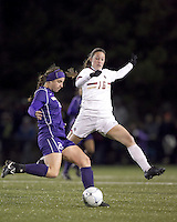 "University of Washington defender Molly Boyd (25) clears the ball as Boston College forward Brooke Knowlton (16) pressures. In overtime, Boston College defeated University of Washington, 1-0, in NCAA tournament ""Elite 8"" match at Newton Soccer Field, Newton, MA, on November 27, 2010."