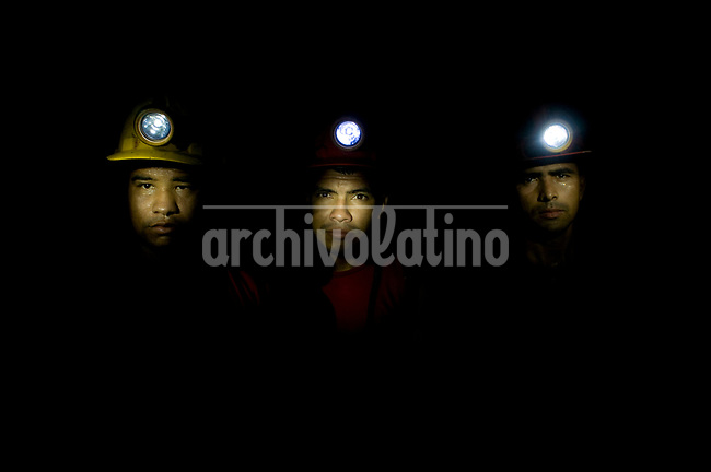 Miners in a tunnel 1,500 feet under ground in a gold mine near Segovia, Antioquia department, Colomb ia